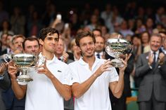 Pierre-Hugues Herbert and Nicolas Mahut hold up the Gentlemens Doubles Trophy
