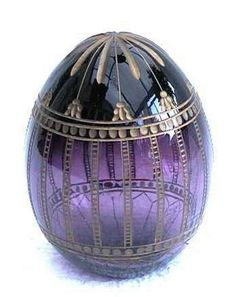 """The story of the Fabergé egg began when Tsar Alexander III decided to give a jeweled Easter egg to his wife the Empress Marie Fedorovna, in 1885 to celebrate the anniversary of their betrothal.(It now need to belong to """"Queen Beanie LeMer"""" Purple Love, All Things Purple, Purple Glass, Purple Rain, Shades Of Purple, Fabrege Eggs, Egg Art, Egg Shape, Saint Petersburg"""