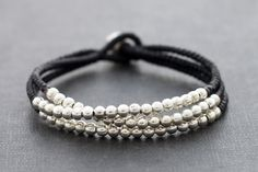This is hand woven bracelet made with black cotton waxed cord weaved together with silver plated metal beads . ♥ Bracelet measures 7.5 inch long ♥