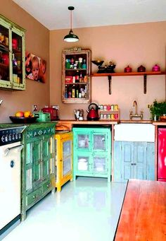 Bohemian kitchen. Love the cabinets!~~~