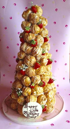 Summer Croquembouche spun with white chocolate and brushed with a gold lustre. See