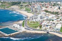 Helicopter flying over Newcastle Beach and Ocean Baths, Newcastle NSW
