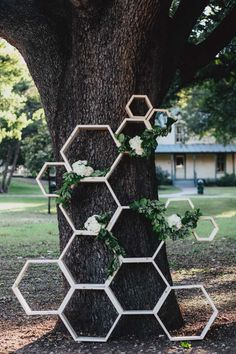 We love the look of this modern wooden hexagon backdrop. With a few supplies from your local hardware store and some lovely florals, you're in business. For an unexpected twist, mount some photos of your loved ones within the hexagon shelves. They'll be right up there at the altar with you as you say your I dos.
