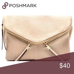 "Beige Rebecca Crossbody & Wristlet Handbag Beige Rebecca Crossbody & Wristlet Handbag with Zipper Details Dimensions - 11""L x 1""W x 7.2""H Adjustable shoulder strap and wrist strap included Vegan leather Gold-tone hardware Interior - 1 zip and 2 slip pockets Exterior - 1 rear zip pocket (2 front zipper is only decorative, not functional) Closure - zip and flap with magnetic snap GlamVault Bags Crossbody Bags"