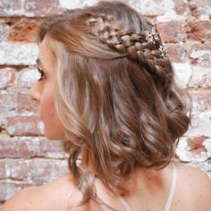 """Brides.com: . Braids aren't going anywhere this year, and with gorgeous styles like this five-strand plait, we can see why. """"It works out perfectly for tucking away longer layers in the front, yet it stays soft and flowy,"""" says Sarah Potempa, Aussie celebrity hairstylist. """"Start off by curling your lob and alternating the direction of the curl so it looks more natural. Then, incorporate your five-strand braid on one side of your head, tie it off with a clear elastic, and pin it under your…"""