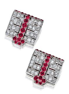-PAIR OF RUBY AND DIAMOND CLIPS, CARTIER, CIRCA 1925 Each of geometric design, set with circular- and brilliant-cut diamonds, decorated with cabochon rubies, signed Cartier and numbered.<3