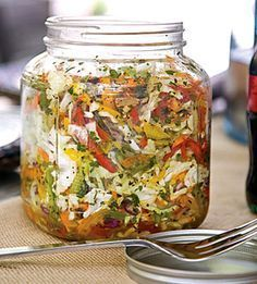Bell Pepper Slaw... I love this stuff! Sometimes I don't sweeten it at all, but when I'm in the mood, I use Stevia. Place slaw mix, peppers, and tomatoes in a large glass jar with lid. Shake to combine; set aside.
