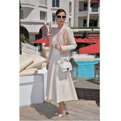 """Actress #CatrinelMarlon wore head-to-toe #FerragamoSS15 with #theFIAMMA handbag and sunglasses to the photo call of her film """"L'Errore"""" at #Cannes2015. Pinned from Salvatore Ferragamo."""