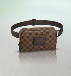 Discover Louis Vuitton Bum Bag Brooklyn: Carried across the body or around the waist, the Bum Bag Brooklyn adds a modern urban edge to any look. Damier Ebène canvas, gold brass pieces and elegant leather trimmings make it casual yet stylish. Louis Vuitton Mens Bag, Louis Vuitton Sale, Louis Vuitton Designer, Louis Vuitton Handbags, Louis Vuitton Monogram, Louis Vuitton Damier, Designer Bags, Prada, Men's Totes