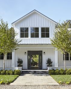 A Modern Farmhouse in San Mateo County | Architecture by Lauren Goldman of l'oro design | Interior Design by Jeanne Moeschler of jm.ID. | Photography by Muffy Kibbey | Modern Sanctuary | Entry | Modern Entry | Exterior | Porch | Lighting | Outdoor Lighting