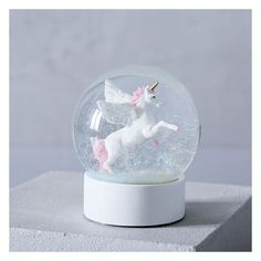 West Elm Unicorn Snow Globe ($24) ❤ liked on Polyvore featuring home, home decor, holiday decorations, west elm, whimsical home decor, glass home decor, glass snow globe and unicorn home decor