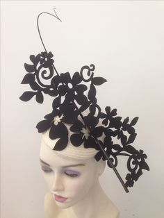 Cream and black fascinator by millinery by miss Lauren