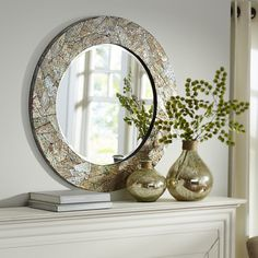 Natural shell nacre forms a glittering mosaic pattern on this dazzling handcrafted, mother-of-pearl porthole mirror. Hang it in a room that needs a little opening up—the iridescent shell and beveled glass have a way of casting light throughout your home. Just like any good mother.