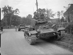 Valentine tanks of 6th Armoured Division in a village during Exercise 'Bumper', 1 October 1941. The white crosses indicate that these are 'enemy' tanks.
