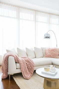 MARIANNA HEWITT HOME TOUR | LIVING ROOM - SECTIONAL COUCH - CHUNKY KNIT BLANKET  - MARBLE TABLE - GALLERY WALL - HIGH CELINGS - NEUTRAL COLORS - BLUSH PINK