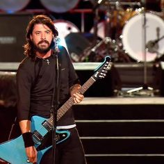 Dave Grohl. just before he was about to do something dumb n cute probs