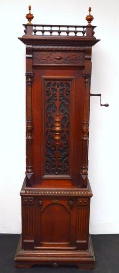Antique Imperial Symphonion Music Box - Rare Turn Of The Century Standing Music Box In Working Order, The Case Is Mahogany And Shows It's Original Or Early Finish, The Cabinet Is Topped By Two Finials Resting On A Gallery Of Baluster Form, Turned Spindles, Top Of Case Opens  -  Liveauctioneers