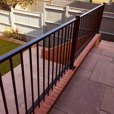 Powder Coated Steel Railings on a brick wall with Raj Blend Paving Steel Railing, Railings, Metal Fence, Brick Wall, Garden Design, Powder, Deck, Stairs, Building