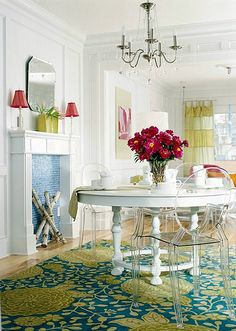 faux fireplace & ghost chairs with white dining table! Love the colors too! Lucite Chairs, Clear Chairs, White Round Tables, Oval Table, Do It Yourself Design, Room Interior, Interior Design, Faux Fireplace, Bathroom Fireplace