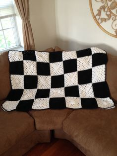 Warm up this winter in this crochet checkered flag afghan.  It consists of 18 white and 17 black granny squares.  This is a MADE TO ORDER item.  It will ship upon completion after receiving payment in 1 to 2 weeks.  100% acrylic