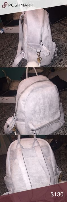 Grey suede backpack It has never been used. Perfect condition! Super soft, product is from the U.K. so saves the hassle of shipping & handling costs. Backpack only, no white puffy chain. Bags Backpacks