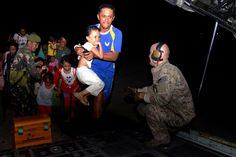 Airman 1st Class Andrew Wiseman,loadmaster with 17th Special Operations Squadron,works with members of Armed Forces of Philippines to assist displaced people boarding MC-130P Combat Shadow Nov.14,2013 at Tacloban,Philippines.Air Force Special Operations Command deployed alongside US Marine Corps Forces Pacific & Armed Forces of Philippines in support of Operation Damayan to provide humanitarian assistance in aftermath of Typhoon Haiyan. (USAF Tech.Sgt.Kristine Dreyer)