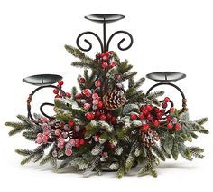 """#burtonandburton Snowy pine candleholder with red berries and pine cones on a metal form that holds 3 candles.Candleholders are 4"""" diameter.14""""H X 17""""W X 7""""D.1 set of 2."""