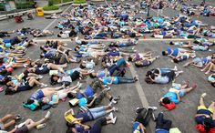 Around 800 students lie on the ground at Chater Garden during Clean Air Network's second annual Airmazing Race in July 2012, to urge the government to put more effort in improving the air quality. Photo: K.Y. Cheng