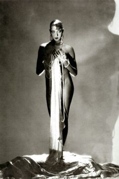 Dripping in pearls and not much else, stage siren Joséphine Baker, photographed here by George Hoyningen-Huene for Vanity Fair,