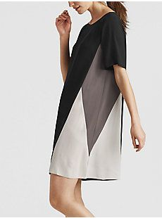 A color-blocked dress in fluid silk. Wear it on its own, or layer it over pants.