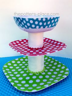 Cake stand made from plastic plates, bowls, and empty cans of food.