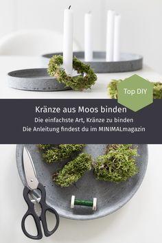 Kränze aus Moos lassen sich ganz einfach selber binden! Wie du die Kränze aus Naturmaterialien bindest, zeige ich dir im MINIMALmagazin!