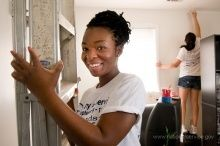 Volunteers work on a painting project during the 2011 9/11 Day of Service