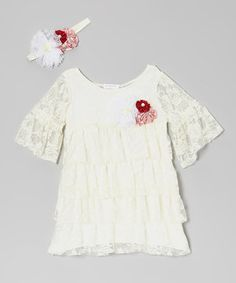 Adorned with sweet satin flowers, this is an outfit made for little angels. The dress boasts bell sleeves and tiers of dreamy lace ruffles, while the frilly headband caps off the ensemble with a burst of gentle blooms.