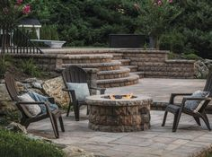 By terracing off a sloped yard with retaining walls, this homeowner was able to emulate the effect of a sunken living room off of the pool deck, creating an intimate fireside gathering spot.