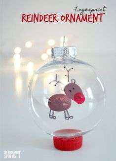 Fingerprint Reindeer Ornament for Preschoolers for Christmas to go along with the story Rudolph the Red Nose Reindeer, a holiday classic book! #eduspin #reindeercrafts #kidsartwork #christmas
