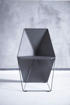 It's faceted, geometric structure wraps around the back for comfort while creating a sculptural silhouette.