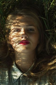 the blades of grass made criss-cross patterns across her face. it made her look like a broken china doll.