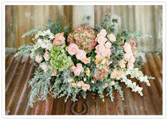 Field roses, milk thistle, snow berry, hydrangeas, chrysanthemums, orchids, and asters