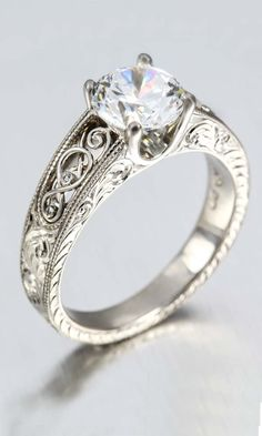 Celtic inspired filigree with tiny diamond accents. Scroll engraving on top and side faces. YES A THOUSAND TIMES YES!!!