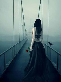 I walk through the valley of the shadow of death in a black dress and heels with a rose and a crow. #gothic