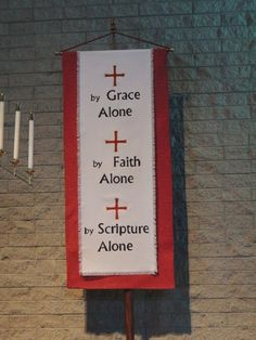 The right Reformation banner overlay shows the three Solas in english. The left banner has the Solas in latin. Made by creating a template out of freezer paper, ironing it onto the fabric, and then using fabric paint.