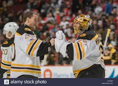 Download this stock image: Chicago, Illinois, USA. 02nd Apr, 2017. - Bruin Goaltender #40 Tuukka Rask (left) congratulates fellow Goaltender #35 Anton Khudobin on the win after the National Hockey League game between the Chicago Blackhawks and the Boston Bruins at the United Center in Chicago, IL. Credit: csm/Alamy Live News - hya05f from Alamy's library of millions of high resolution stock photos, illustrations and vectors.
