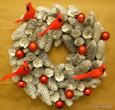 Make a Wintery Pine Cone Wreath - I personally, would not have the birds