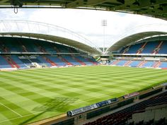 The Galpharm Stadium, Huddersfield Town, as known as the Alfred McAlpine Stadium. English Football Stadiums, Huddersfield Town Fc, Brentford, Sports Stadium, Sense Of Place, England And Scotland, West Yorkshire, European Football, Terriers