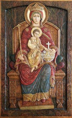 Virgin Mary enthroned bas relief