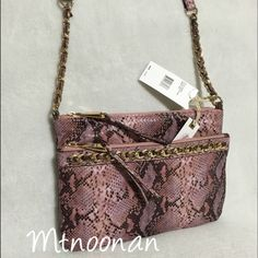"""Jessica Simpson Tyra Pink Python Purse Jessica Simpson Tyra Pink Python Triple Compartment Purse. Can be worn on the shoulder or as a crossbody!  • MSRP $78.00 • Dimensions: 10""""L x 2""""D x 7""""H with 58"""" adjustable strap • Has 3 separate compartments. Interior of largest compartment in back includes 2 slip pockets and a zipper pocket • Front and back compartments have top zipper closures • Gold tone hardware and chain detail   I have more JESSICA SIMPSON, Check out my other items!  ❌ NO TRADES…"""