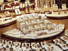 Gold jewelry collection on display in a store window.
