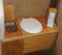 Note the sawdust compartment on this composting toilet. My spouse is urgently demanding an outhouse, so this looks very good to me!