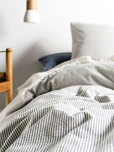 Ellington Indigo Quilt Cover Set - This stone-washed cotton seersucker stripe has a natural simplicity and a lovely soft handle. Layer with linens and rustic weaves for a cosy, textural appeal.